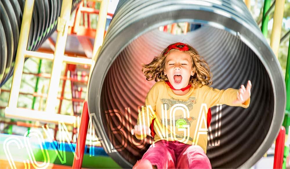 child enjoying the slide at brooklyn green meadows farm ny